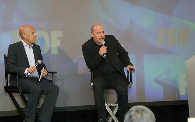 """""""Fauda"""" co-creators Avi Issacharoff, left, and Lior Raz speaking at the FIDF New Jersey Chapter Annual Tribute Dinner. Photo by Aron Michael Photography"""
