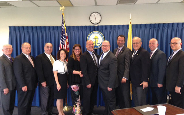 Federation leaders and state officials at the security meeting included, from left, Jacob Toporek, Col. Rick Fuentes, Drew Staffenberg, Robin Wishnie, Jennifer Dubrow-Weiss, Jason Shames, Christopher Porrino, Dov Ben-Shimon, Gordon Haas, Keith Krivitzky,