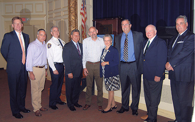 Peter Feinberg, second from left, organized a gun safety forum in Millburn that included, from left, superintendent of schools James Crisfield, Lt. Peter Corbo of the Essex County Sheriff's Office, Assemblyman John McKeon, Millburn Mayor Robert Till