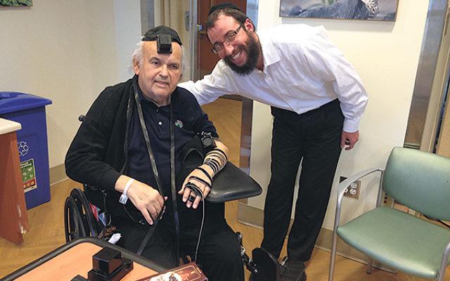 The late Howard Feinstein, wearing tefillin, with Rabbi Zalman Notick.