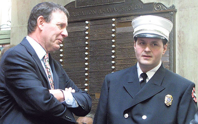 Rabbi Simon Rosenbach, left, chats with Newark Fire Department chaplain Rabbi Isaac Frankel before the awards ceremony.