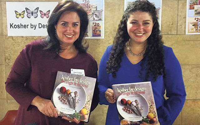 """Susie Fishbein and her daughter Katie sell the last """"Kosher by Design"""" installment at a recent event."""