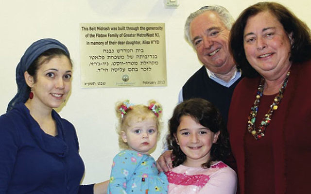 Roz and Stephen Flatow, right, their daughter-in-law Shaina, and granddaughters Maayan Alisa, left, and Michal, at the dedication of the beit midrash, study center, created in the name of their daughter Alisa at MetroWest High School in Ra'