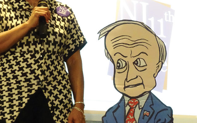 Moderator Tammy Williams stands beside a cardboard replica of Rep. Rodney Frelinghuysen (R-Dist. 11), who did not appear at a Feb. 23 town hall meeting at Temple B'nai Abraham in Livingston. Photos by Robert Wiener