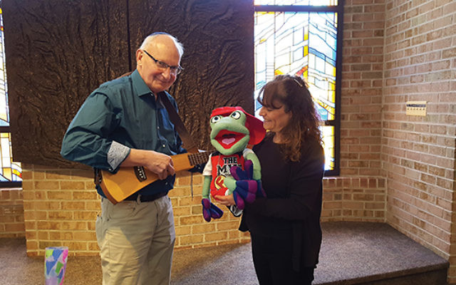 Frog, star of a new Haggadah, with its creators Rabbi Ron Isaacs and Karen Rostoker-Gruber at Temple Sholom in Bridgewater. Photo courtesy Dorit Yehudai