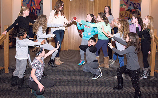 Young people rehearse as Queen Vashti attempts to give King Ahashverosh a poison apple during the Purimshpiel based on Disney's The Descendants.