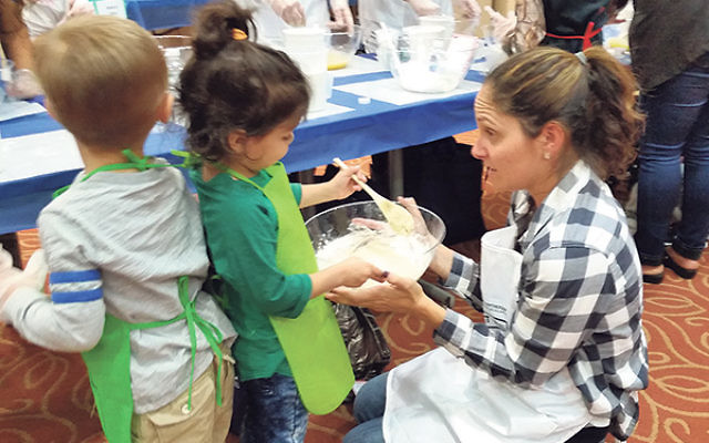 """Loren Levy — a Partnership """"family connector"""" — mixes it up with her daughter Liana at the Cooperman JCC in West Orange."""