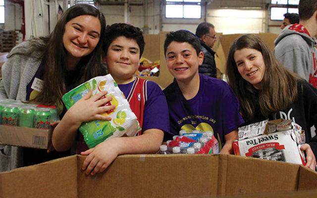 Students volunteering at the Community FoodBank of NJ helped sort boxes of food to be distributed to food pantries, shelters, and soup kitchens.
