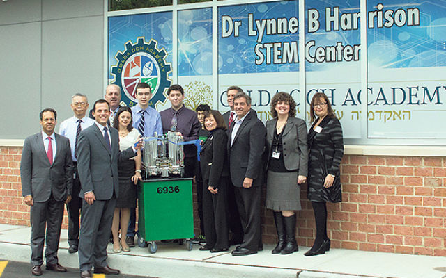 Celebrating the official opening of the Dr Lynne B Harrison STEM Center at Golda Och Academy are, from left, back row, GOA board vice chair Mark Wilf, robotics team coach and physics teacher Dr. Arco Jeng, Mark Ginsberg, robotics team president Ben Soudry