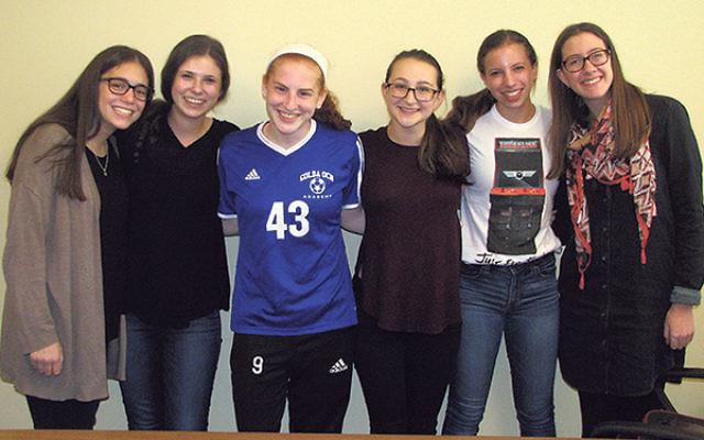 Founders of Golda Och Academy's Breast Cancer Awareness Club include students, from left, Talia Feldman, Shira Kalet, Emily Binstein, Mikayla Talmud, Hannah Sturm, and Maddy Lefkowitz.