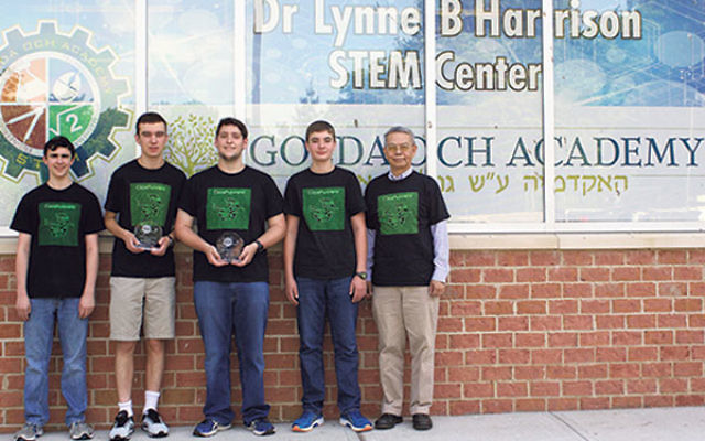 With adviser Dr. Arco Jeng, far right, are GOA's CodeRunners RoboCup team members who will compete in the International RoboCup Junior Soccer Competition in Leipzig, Germany, later this month, from left, Aytan Geschwind, Benjamin Soudry, Alex Rothsc