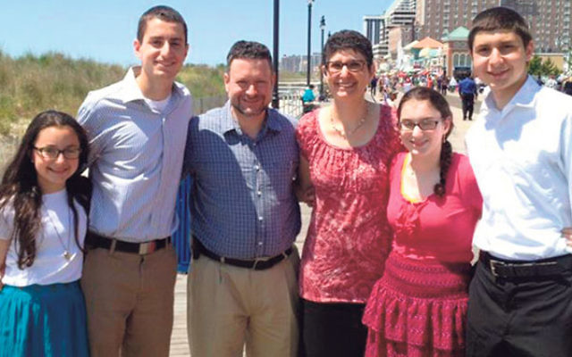 Rabbi Aaron Gaber and his wife, Sharon Bromberg, with their kids, from left, Reena, Benjamin, Aliza, and Yonah.