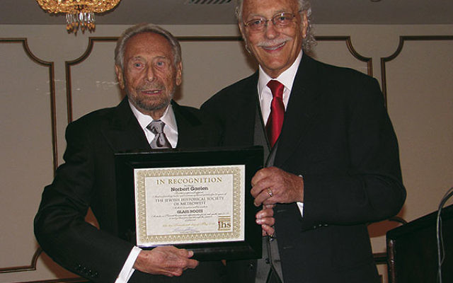 Norbert Gaelen, left, was honored at the annual Jewish Historical Society of MetroWest gala for his role as a founder and major benefactor in May 2011; presenting his certificate of recognition is then JHS president Howard Kiesel.