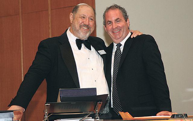 Honoree Cantor Stuart Binder, right, with Rabbi Eric Wisnia.
