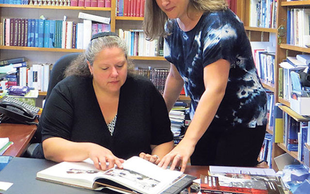 Stacy Gallin, right, discusses her proposed seminar on Nazi medical experimentation with Rabbi Melinda Panken of Temple Shaari Emeth in Manalapan.