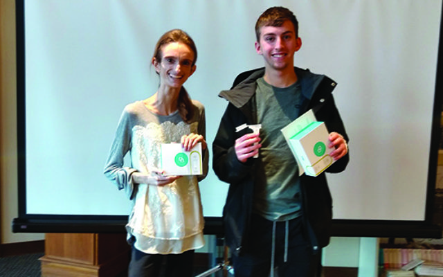 Rutgers students Dena Winchester, who has a rare genetic disease, and Oren Mendelow of West Orange, with the DNA genetic screening kits given to Jewish students in a drive conducted by JScreen. Photos by Debra Rubin