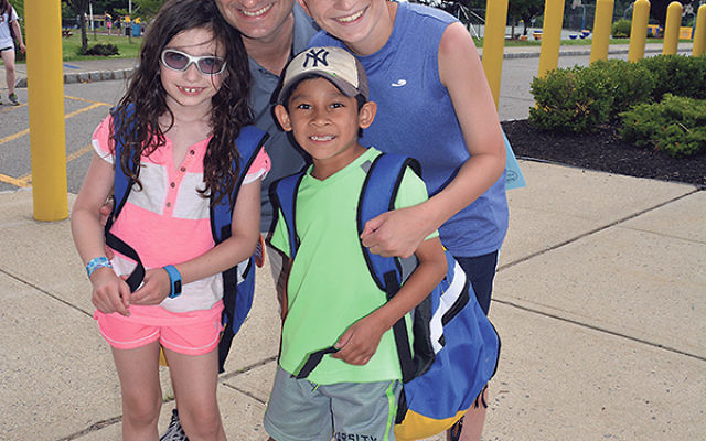 Scott Lantzman on the first day of camp, 2015, with his children.