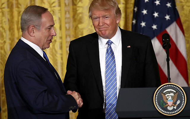 President Trump and Israeli Prime Minister Netanyahu at the White House in February. Without a clear Mideast policy, Trump's upcoming visit raises many questions. Getty Images
