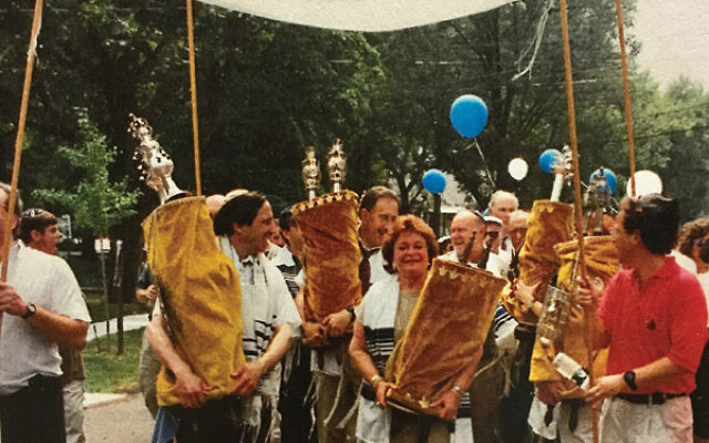 The Torah procession from Suburban Jewish Center Mekor Chayim to Temple Beth-El when the synagogues merged in 1998.
