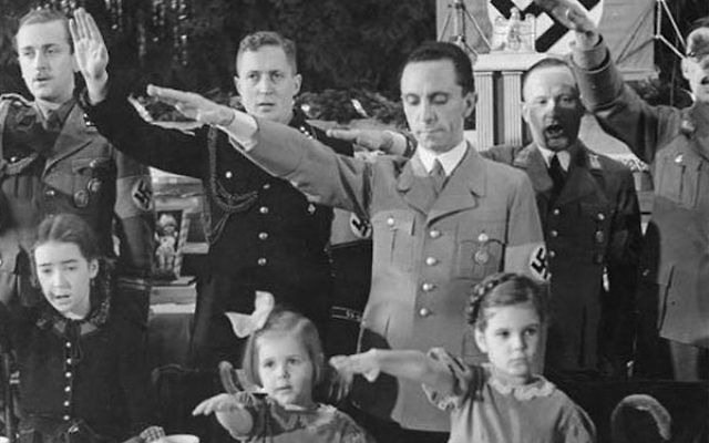 Joseph Goebbels with his daughters, Helga (right) and Hilde, at a Christmas celebration in Berlin, 1937. (German Federal Archives)