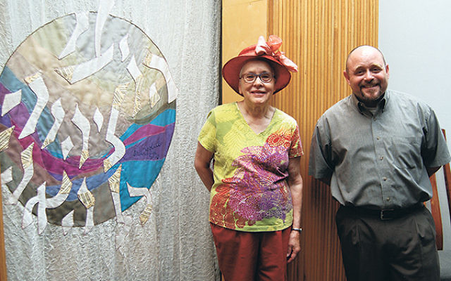 Ina Golub, with Rabbi Douglas Sagal, at the unveiling of the ark curtain she designed and made for Temple Emanu-El in Westfield in memory of her late husband, Herb.
