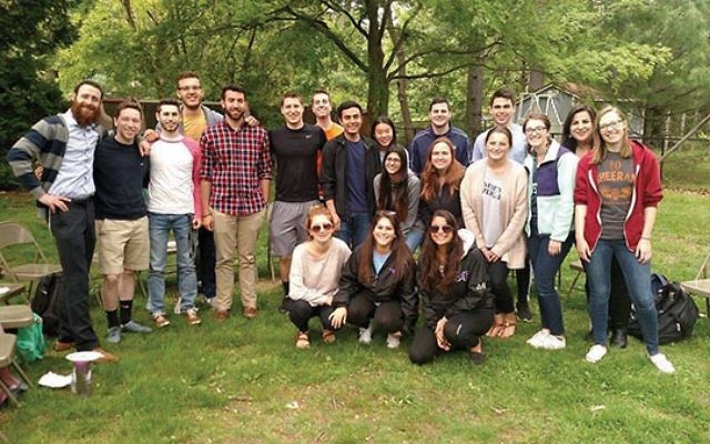 Rabbi Akiva Greenbaum, left, with students from his mental wellness and Jewish thought class at The College of New Jersey. Photos courtesy Akiva Greenbaum