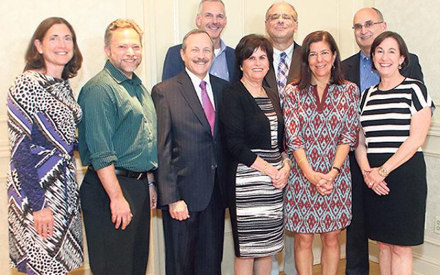 Members of the Greenwood House capital campaign committee, from left, Stacey Mann, Dan Goodman, Marc Citron, Jeff Perlman, Marissa Treu, Richard Goldstein, Carol Golden, Conrad Druker, and Susan Falcon.