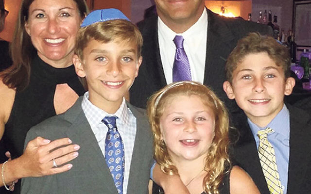 The Brandt/Popolow family at a recent bar mitzva. The boys, Alex, right, and Jacob, will celebrate becoming b'nei mitzva next spring. Their parents, Shari Brandt and Brett Popolow, are excited to take advantage of the new option for their sons; they