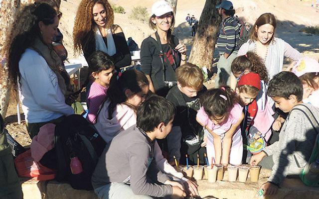 Arab and Jewish Hagar students celebrate Hanukka last December.