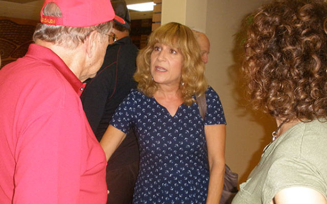 Israeli-American radio broadcaster Eve Harow continues the discussion of the American election and Israeli-U.S. relations with audience members at the Temple Beth El program.