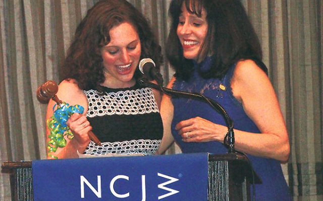 Melanie Harrison, left, passes the gavel to her mother, Shari Harrison, who was installed as the new president of NCJW/Essex.