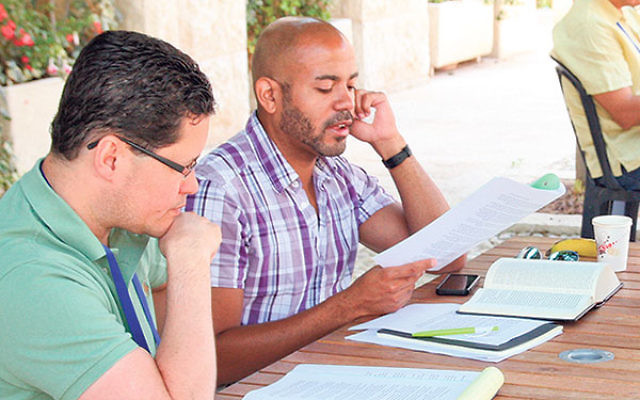 Javier Viera, dean of the Drew University Theological School, left, and Brian Rainey, assistant professor of Old Testament at Princeton Theological Seminary, study at the Hartman Institute in Jerusalem.