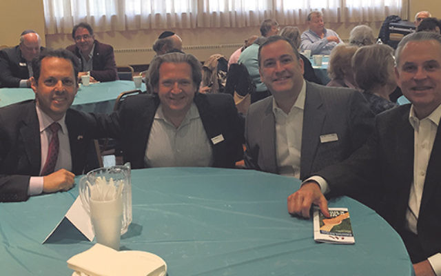 At the Cafe Europa celebration are, from left, JFNA Holocaust Survivor Initiative national chair Mark Wilf of Livingston, with Greater MetroWest initiative chairs Alan Pines and Murray Halpern and David Halpern.