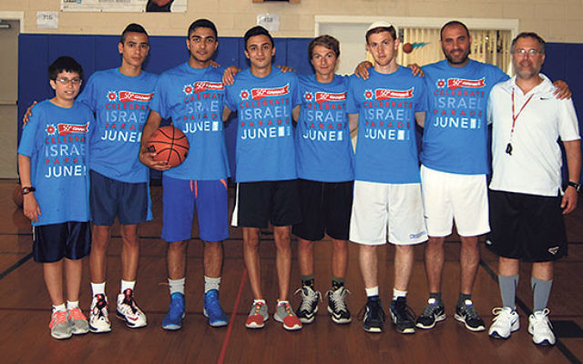 Hoop Connections participants — from left, Nadav Adler, Afik Edri, Matan Kabassa, Eden Cohen, Sam Berkley, Orel Sananes, Israeli coach Meir Dayan, and Hoop Connections founder Craig Goldman — before giving a training at the JCC of Central NJ.&