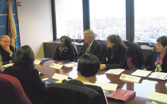 Sen. Robert Menendez meets with members of the NJ Coalition Against Human Trafficking​, including Melanie Roth Gorelick, second from right.