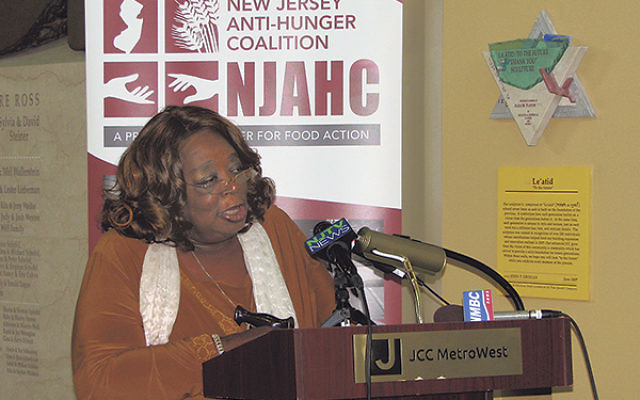 """Mary, whose photos of her medicine bottles and walker are included in the """"NJ Soul of Hunger"""" exhibit, said she can't afford to buy both nutritious food and her medications."""