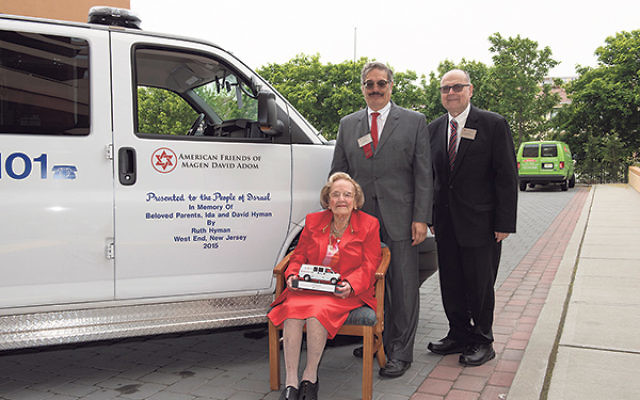 Ruth Hyman is joined in front of her newly sponsored MDA ambulance by AFMDA legacy giving adviser Jeff Lipkin, left, and AFMDA northeast regional director Gary Perl.