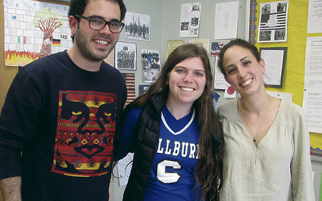 With Hen and Sharon is MHS senior Olivia Lange, center, a StandWithUs MZ Teen intern who organized the former IDF soldiers' visit to her school.