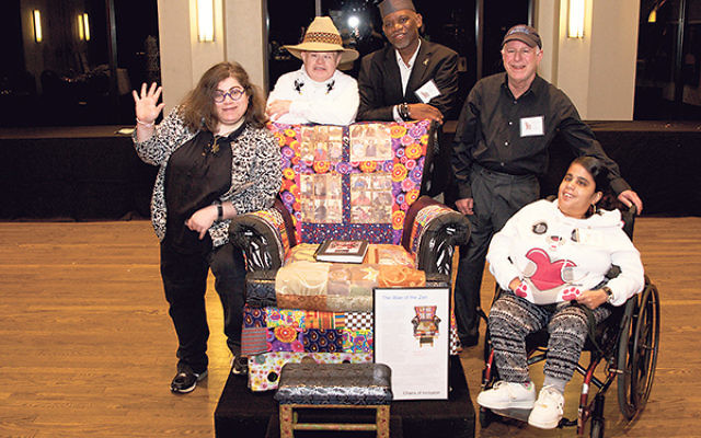 "The Wae Center team who created the ""Wae of the Zen"" chair with lead artist Mansa Mussa, center, who will conduct a hands-on workshop in Asbury Park for art educators with a focus on special needs."