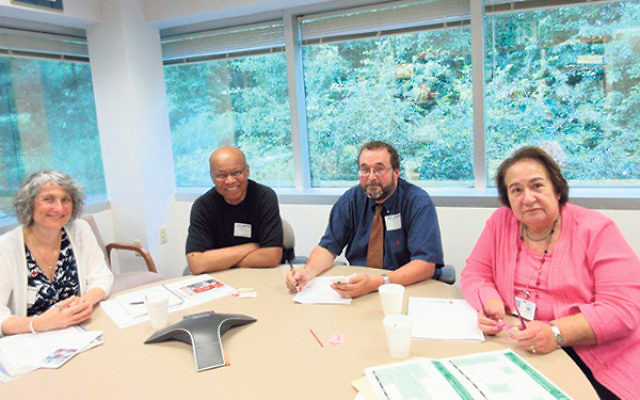 Among those who met in Whippany to discuss training chaplains in disaster relief are, from left, Jocelyn Gilman, the Rev. Willard Ashley, Rabbi Stephen Roberts, and Cecille Asekoff.