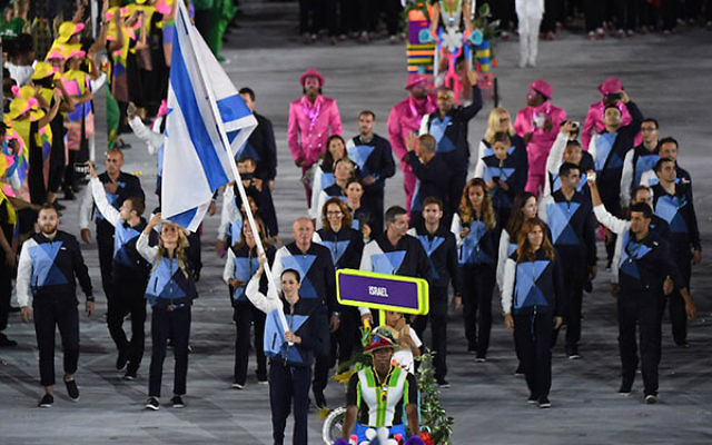 Israel's flagbearer, Neta Rivkin, leading her delegation during the opening ceremony of the Rio 2016 Olympic Games at the Maracana stadium in Rio de Janeiro, Aug. 5, 2016. (Pedro Ugarte/AFP/Getty Images)