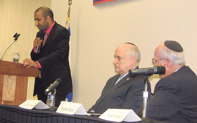 Kasim Hafeez described his trajectory from hater of Israel to Zionist at the Stand Up for Israel Advocacy Summit on Nov. 2. Listening are Malcolm Hoenlein, left, and Gordon Haas.