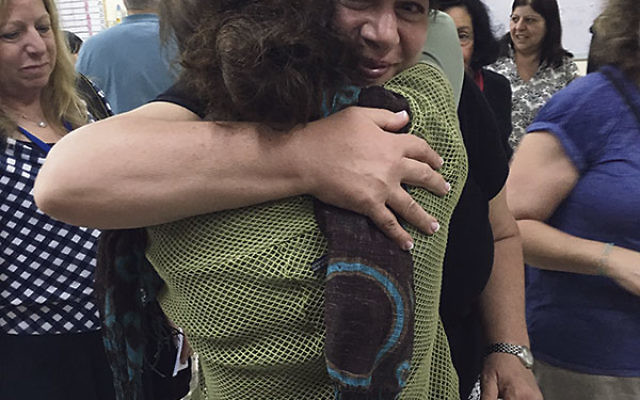 Tanzman fellow Cheryl Minkoff hugs a client of Amit Shikum, a federation-funded project that provides vocational rehabilitation to mentally ill people, in Nazereth.