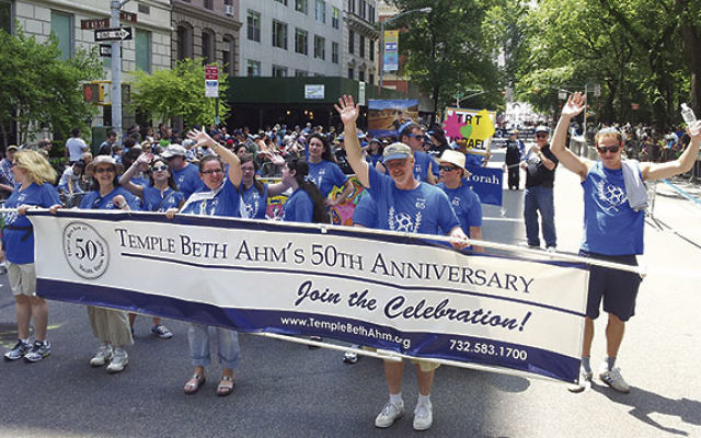 Marchers from Temple Beth Ahm, Aberdeen, pause for a picture during the 2013 parade.