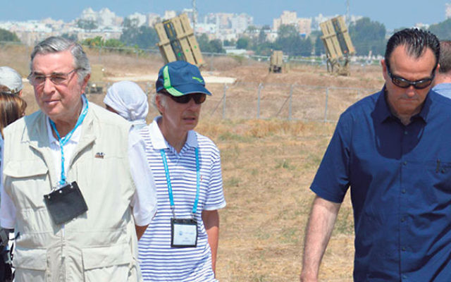 Len Posnock, left, and other JFNA solidarity mission members in front of Iron Dome installations.