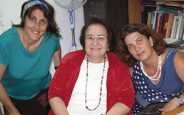 In Jerusalem Cecille Asekoff, center, confers with certified Israeli spiritual care providers Einat Ramon, left, and Hila Zemer.