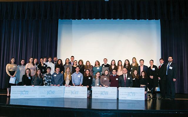 High school seniors and JCYF graduates at the check presentation ceremony. Photos courtesy JCYF