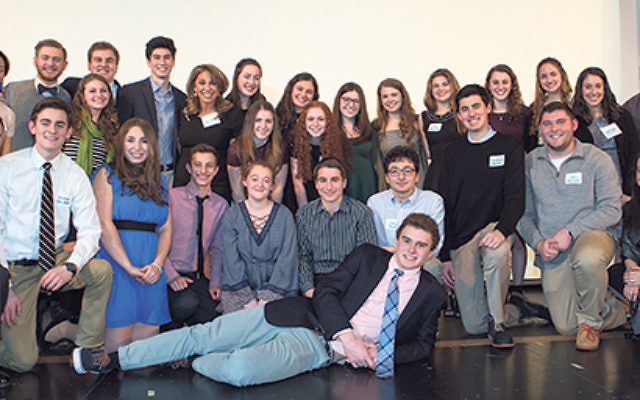 Jewish Community Youth Foundation founder Ricky Shechtel, back row, fifth from left, with the program's graduating seniors.