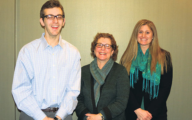 With support coordinator Maggie McCourt, right, at the JFS of MetroWest office in Florham Park are Harris Engel and his mother Helen.