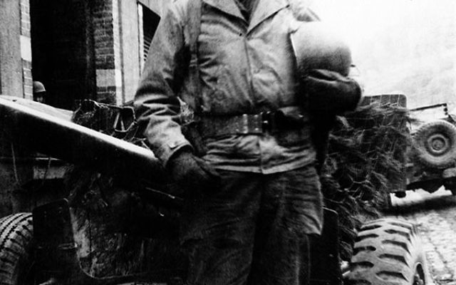 Private First Class Seymour Litwack of Newark, 19, at his jeep, prior to his participation in the Battle of the Bulge.